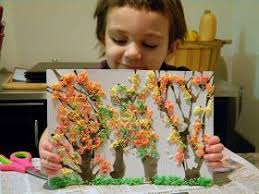 Little girl with her tactile art trees.