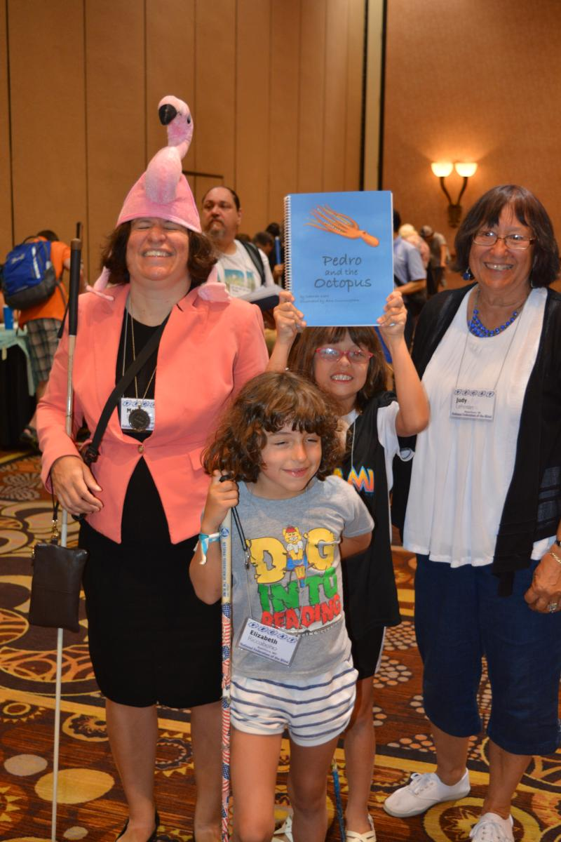 Melissa Riccobono with daughters Oriana and Elizabeth and grandmother Judith show off their copy of Pedro and the Octopus